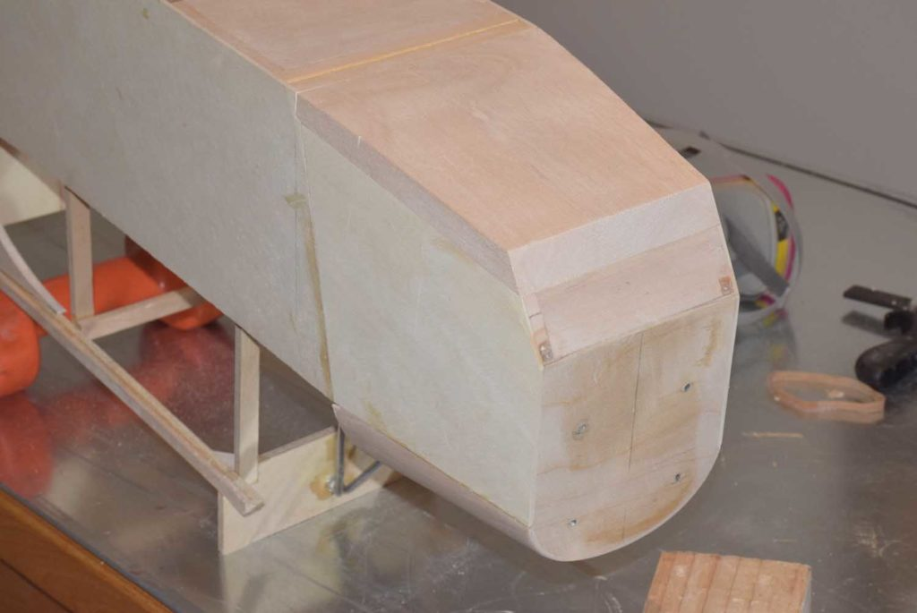 Sanding the main floor to match the rest of the fuselage shape.